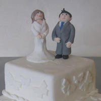 bride and groom wedding cake from grange bakery, grange over sands, cumbria
