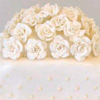 white roses wedding cake from grange bakery, grange over sands, cumbria